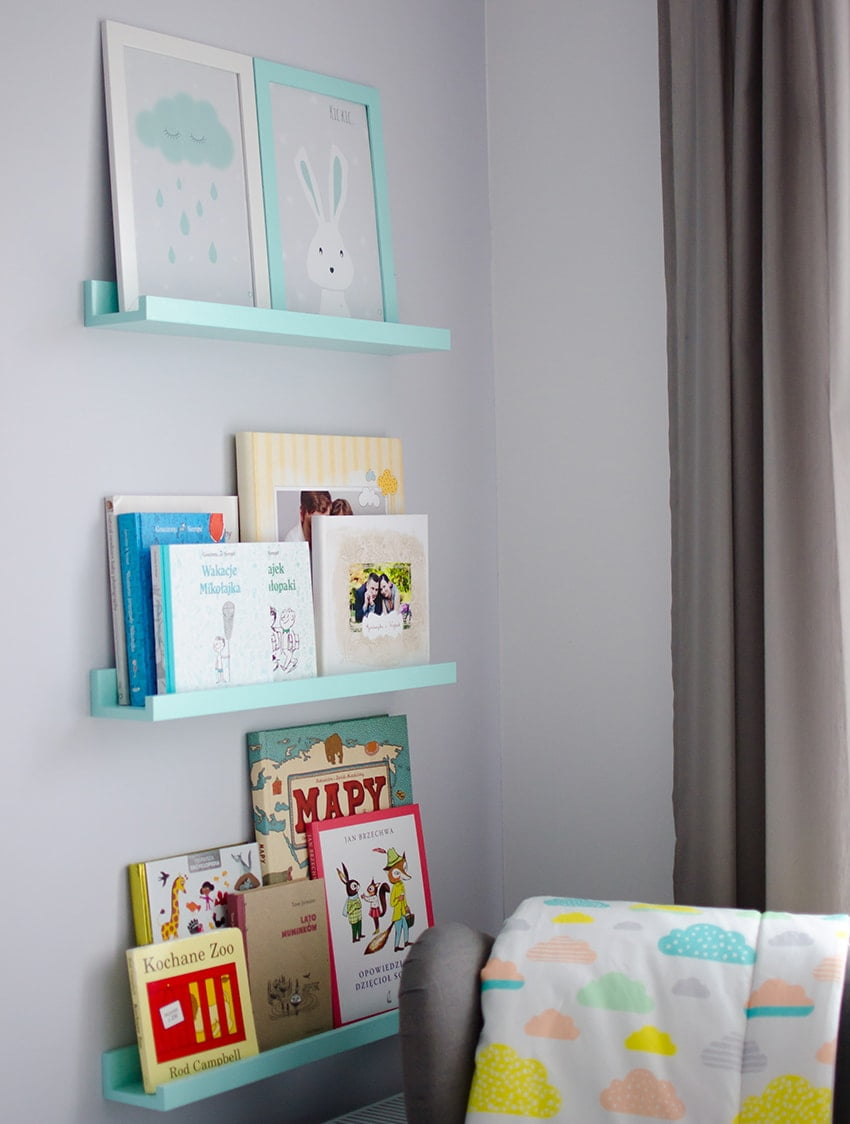 boy's room with mint shelves